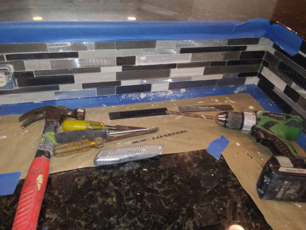 Glass and metal mosaic strip for kitchen backsplash